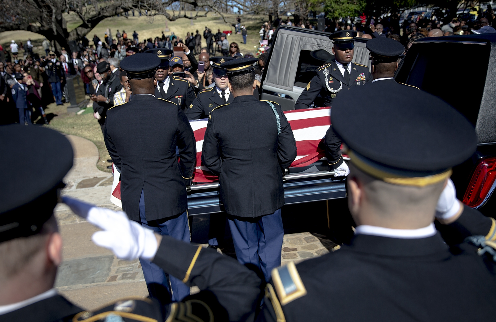 Members of an honor guard removes the casket of WWII veteran Richard Overton from a hearse during a burial ceremony at the Texas State Cemetery on Saturday, Jan. 12, 2019, in Austin, Texas. Overton, the nation's oldest World War II veteran who at 112 was believed to be the oldest living man in the U.S., was remembered for his love of country and joy for life. (Nick Wagner/Austin American-Statesman via AP)
