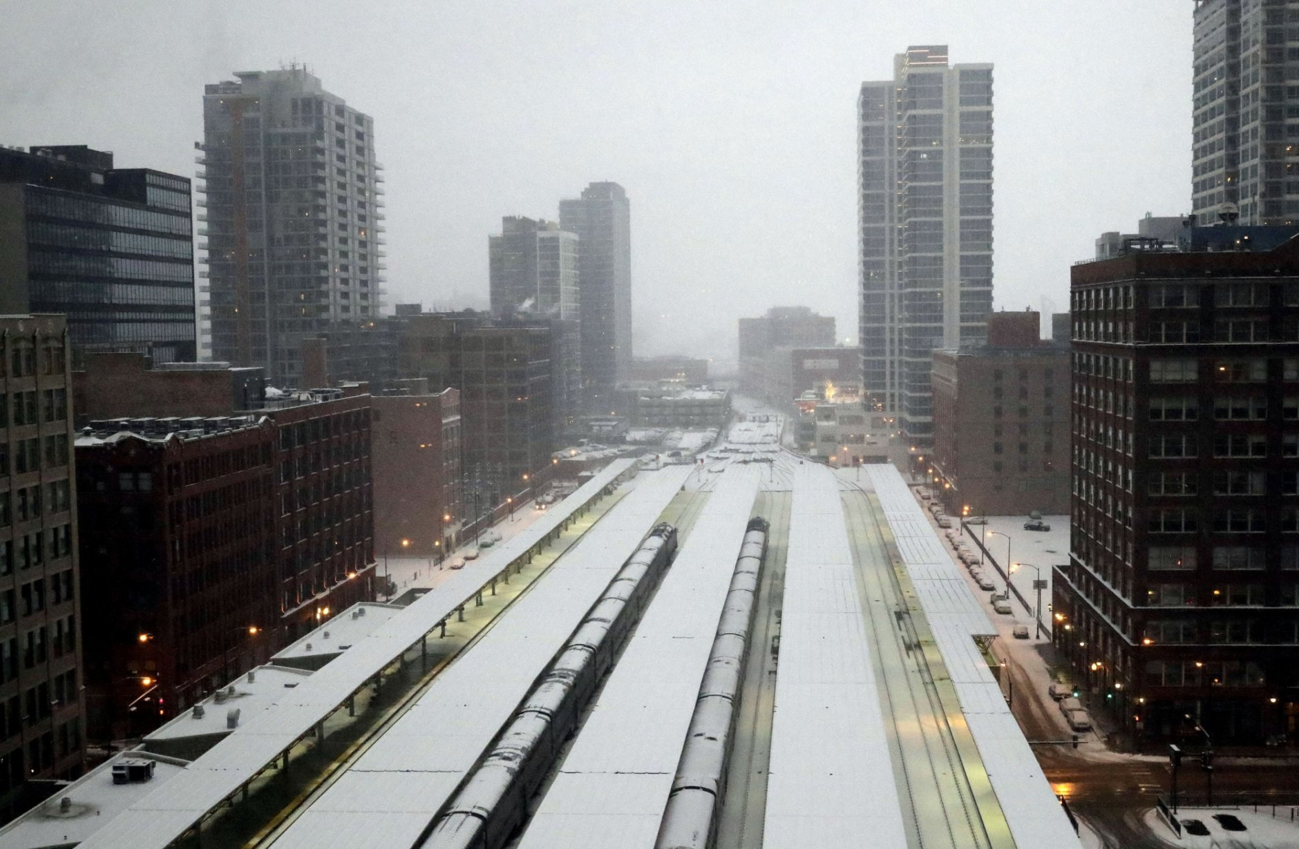 Commuter trains are parked at the LaSalle Street station under a heavy snow fall in downtown Chicago, Saturday, Jan. 12, 2019. A winter weather advisory is in effect until 3 a.m. Sunday and covers northern Illinois and Northwest Indiana including Lee, DeKalb, Kane, DuPage and Cook counties. (AP Photo/Nam Y. Huh)
