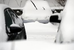 Cars are covered by snow, Monday, Jan. 28, 2019, in Wheeling, Ill. A winter storm brought more than 5 inches of snow to northern Illinois as the region braced itself for record-low subzero temperatures. (AP Photo/Nam Y. Huh)