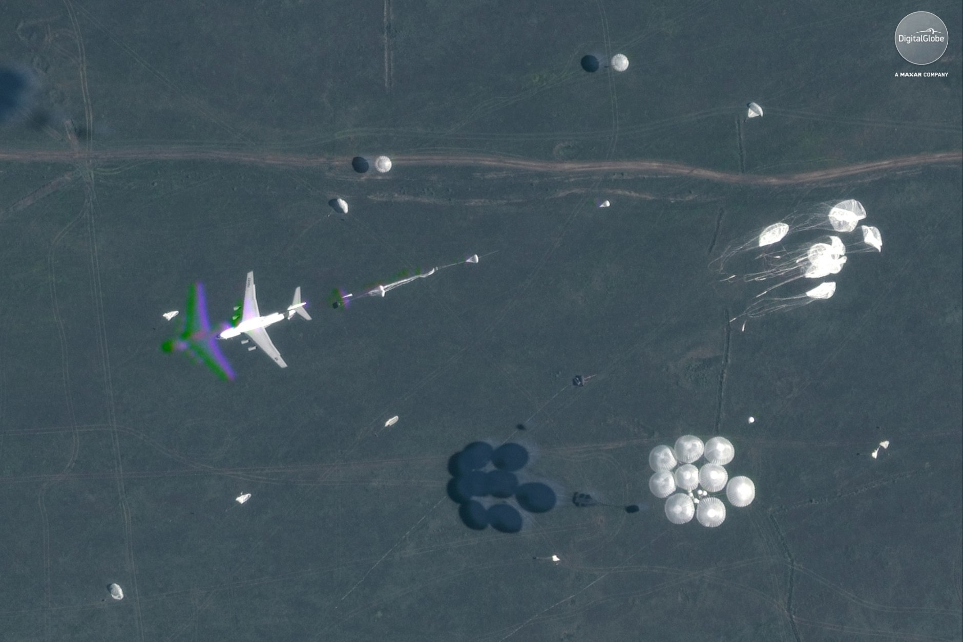 This Sept. 13, 2018 satellite image provided by DigitalGlobe shows an airborne paradrop during the Vostok military exercises in the Eastern Siberia area of Russia. (DigitalGlobe, a Maxar company via AP)