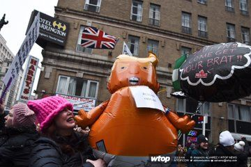 Swarms of the Trump baby balloons being paraded down Pennsylvania Ave. The balloons modeled after the giant blimp that took flight during Trump's visit to London last summer. (WTOP/Alejandro Alvarez)