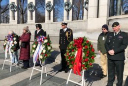 Helping lay the wreaths at the Tuesday ceremony were British and Canadian military dignitaries. From left: Chaplain Lt. Col. Todd Wolf; Cmdr. Richard McHugh; and Maj. Jeff Pederson. (WTOP/Kristi King)