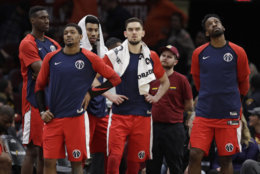 The Washington Wizards bench watches late in the second half of an NBA basketball game against the Cleveland Cavaliers, Tuesday, Jan. 29, 2019, in Cleveland. (AP Photo/Tony Dejak)