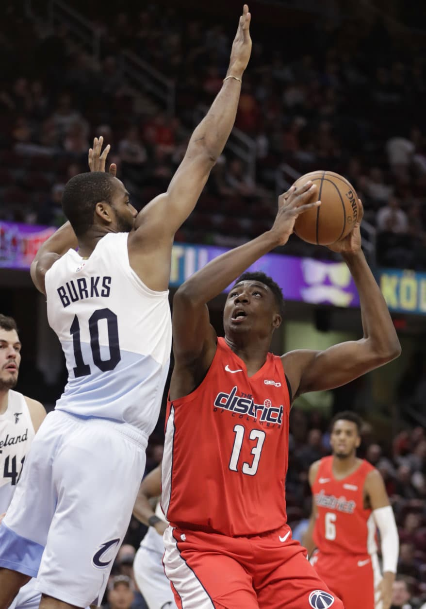 Washington Wizards' Thomas Bryant (13) drives against Cleveland Cavaliers' Alec Burks (10) in the second half of an NBA basketball game, Tuesday, Jan. 29, 2019, in Cleveland. (AP Photo/Tony Dejak)