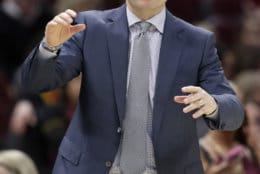 Washington Wizards coach Scott Brooks watches late in the second half of the team's NBA basketball game against the Cleveland Cavaliers, Tuesday, Jan. 29, 2019, in Cleveland. The Cavaliers won 116-113. (AP Photo/Tony Dejak)