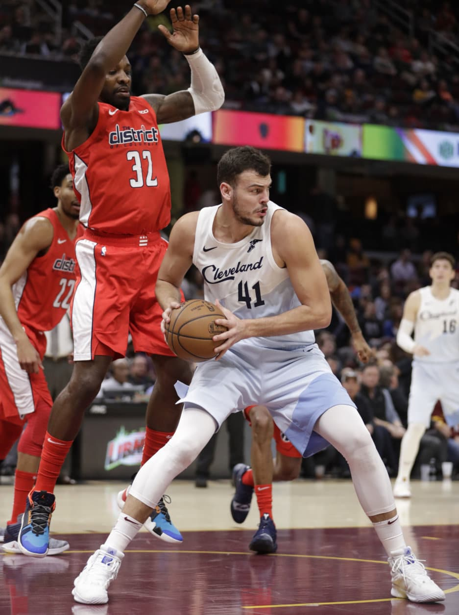Cleveland Cavaliers' Ante Zizic (41) is defended by Washington Wizards' Jeff Green (32) during the first half of an NBA basketball game Tuesday, Jan. 29, 2019, in Cleveland. (AP Photo/Tony Dejak)