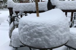 Almost 11 inches of snow on a backyard table in Bethesda. (WTOP/Dick Uliano)