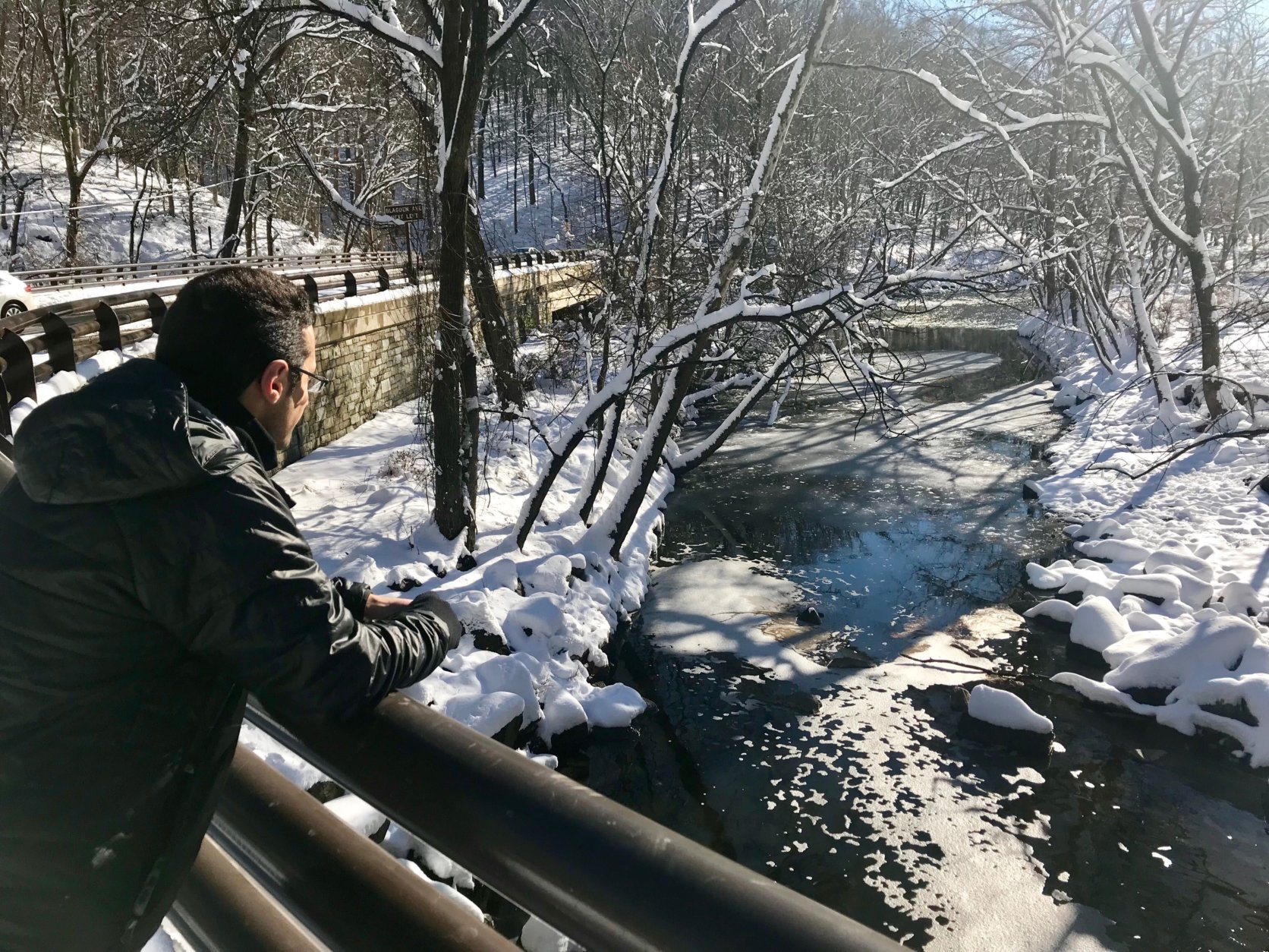 WTOP Reporter Dave Dildine looks over Broad Branch Creek where he first spotted a woman drowning on Sunday, January 13. (WTOP/Megan Cloherty)