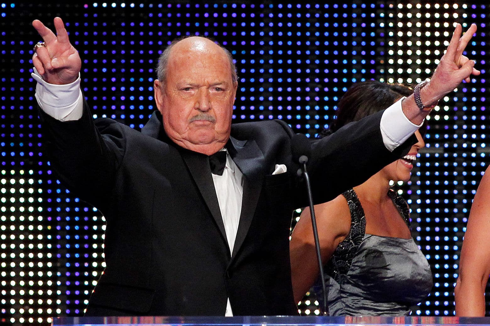 "Gene ""Mean Gene"" Okerlund speaks during the WWE Hall of Fame Induction at the Smoothie King Center in New Orleans on Saturday, April 5, 2014. (Jonathan Bachman/AP Images for WWE)"