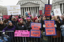 Participants take part in a Women's rally in lower Manhattan on Saturday, Jan. 19, 2019 in New York.   A march through midtown Manhattan is being organized by the Women's March Alliance for the third year. But the downtown Manhattan rally at roughly the same time is being organized by a chapter of Women's March Inc., the group formed to help organize the 2017 demonstration in Washington.  Women's March Inc. co-leader Tamika Mallory, who is black, has come under her fire from Jewish groups for her support of Nation of Islam leader Louis Farrakhan, who is known partly for his anti-Semitic rhetoric and condemnations of homosexuality. (AP Photo/Kathy Willens)