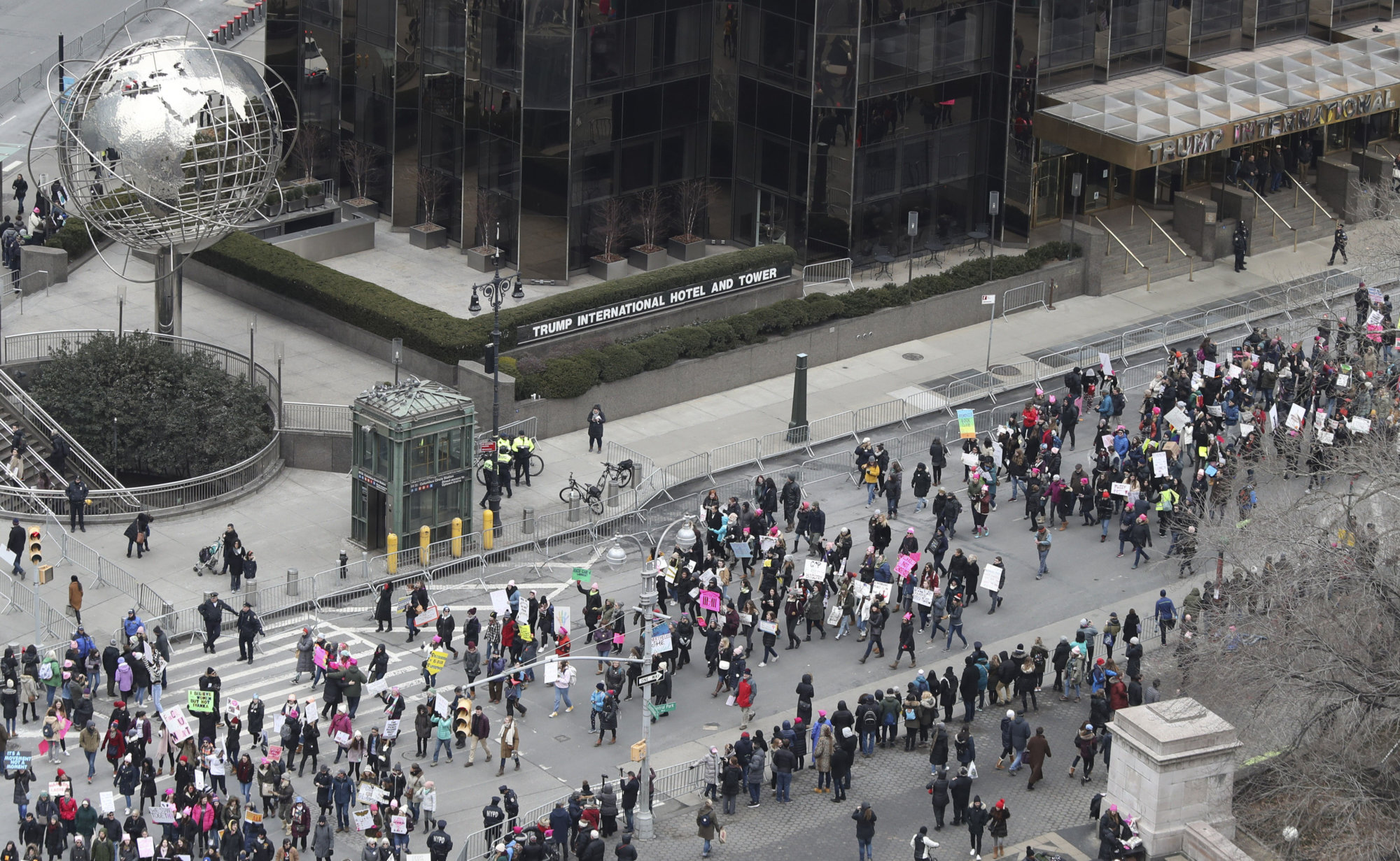 Demonstrators march past the Trump International Hotel and Tower during the Women's March Alliance, Saturday, Jan. 19, 2019, in New York. (AP Photo/Mary Altaffer)