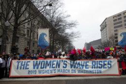 Demonstrators march on Pennsylvania Av. during the women's march in Washington on Saturday, Jan. 19, 2019. (AP Photo/Jose Luis Magana)