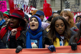 Co-presidents of the 2019 Women's March, Linda Sarsour, center, and Tamika Mallory, right, join other demonstrators on Pennsylvania Avenue during the Women's March in Washington on Saturday, Jan. 19, 2019. (AP Photo/Jose Luis Magana)