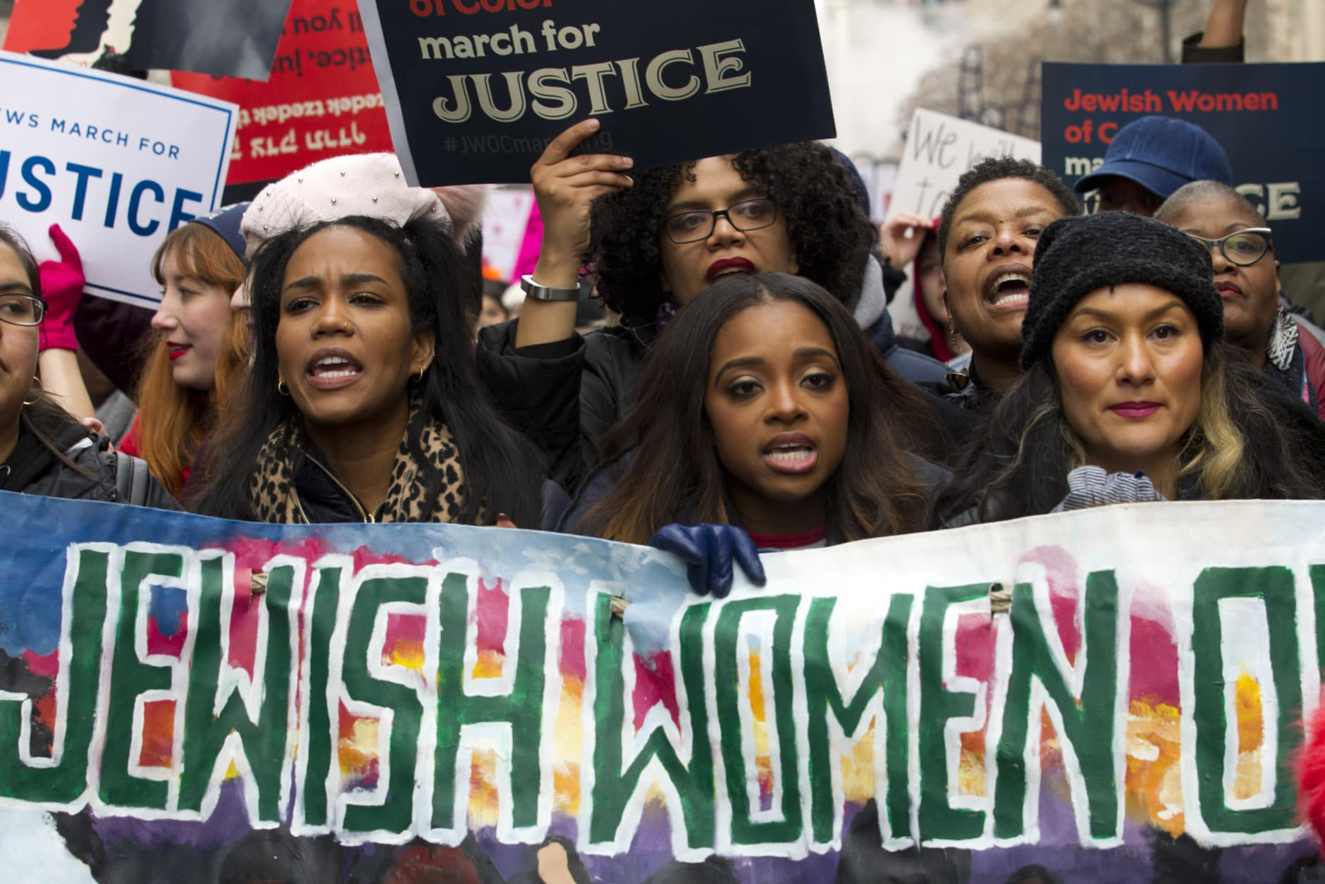 Co-president of the 2019 Women's March, Tamika Mallory, center, joins other demonstrators on Pennsylvania Avenue during the Women's March in Washington on Saturday, Jan. 19, 2019. (AP Photo/Jose Luis Magana)