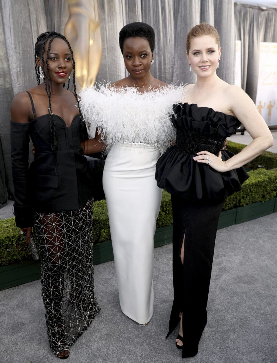 Lupita Nyong'o, from left, Danai Gurira, and Amy Adams arrive at the 25th annual Screen Actors Guild Awards at the Shrine Auditorium & Expo Hall on Sunday, Jan. 27, 2019, in Los Angeles. (Photo by Matt Sayles/Invision/AP)
