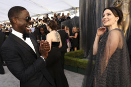 Sterling K. Brown, left, and Sophia Bush appear at the 25th annual Screen Actors Guild Awards at the Shrine Auditorium & Expo Hall on Sunday, Jan. 27, 2019, in Los Angeles. (Photo by Matt Sayles/Invision/AP)