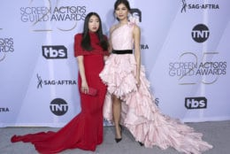 Awkwafina, left, and Gemma Chan arrive at the 25th annual Screen Actors Guild Awards at the Shrine Auditorium & Expo Hall on Sunday, Jan. 27, 2019, in Los Angeles. (Photo by Willy Sanjuan/Invision/AP)