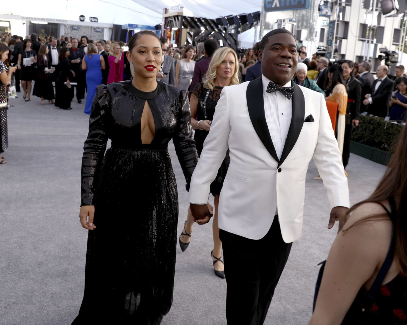 Megan Wollover, left, and Tracy Morgan arrive at the 25th annual Screen Actors Guild Awards at the Shrine Auditorium & Expo Hall on Sunday, Jan. 27, 2019, in Los Angeles. (Photo by Matt Sayles/Invision/AP)