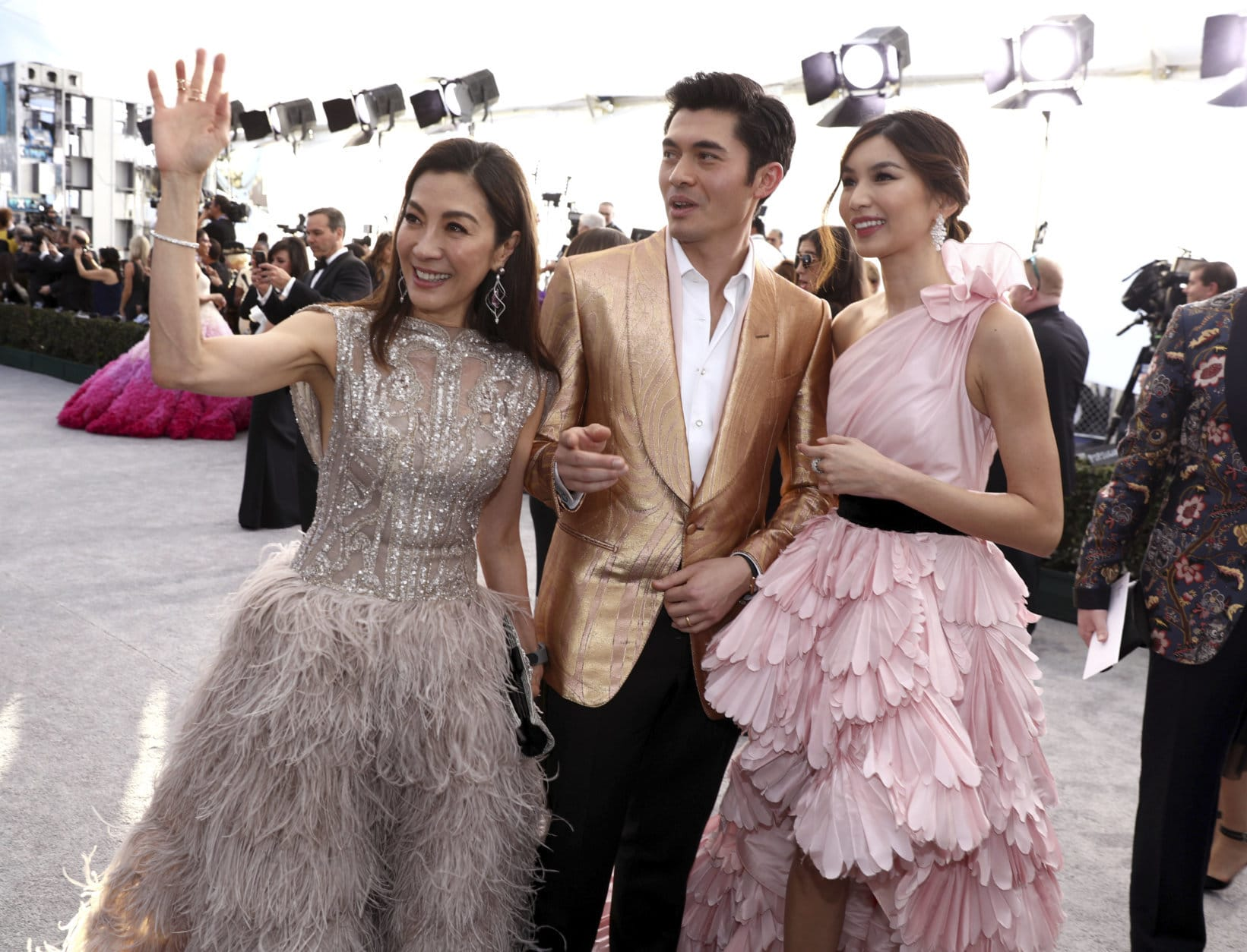 Michelle Yeoh, from left, Henry Golding and Gemma Chan arrive at the 25th annual Screen Actors Guild Awards at the Shrine Auditorium & Expo Hall on Sunday, Jan. 27, 2019, in Los Angeles. (Photo by Matt Sayles/Invision/AP)