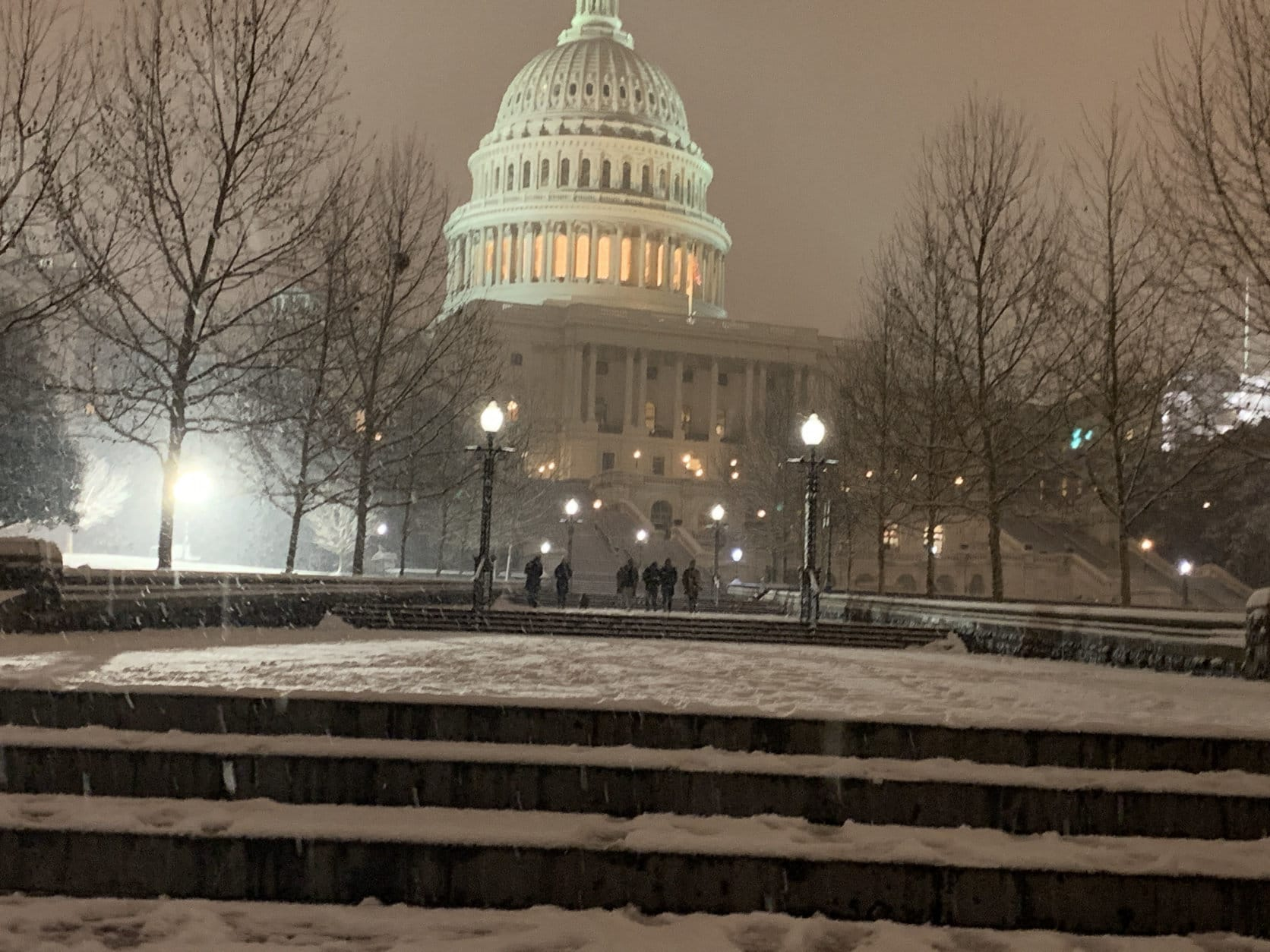 The U.S. Capitol is under a blanket of snow of Saturday, Jan. 12, 2019. (WTOP/Kyle Cooper)