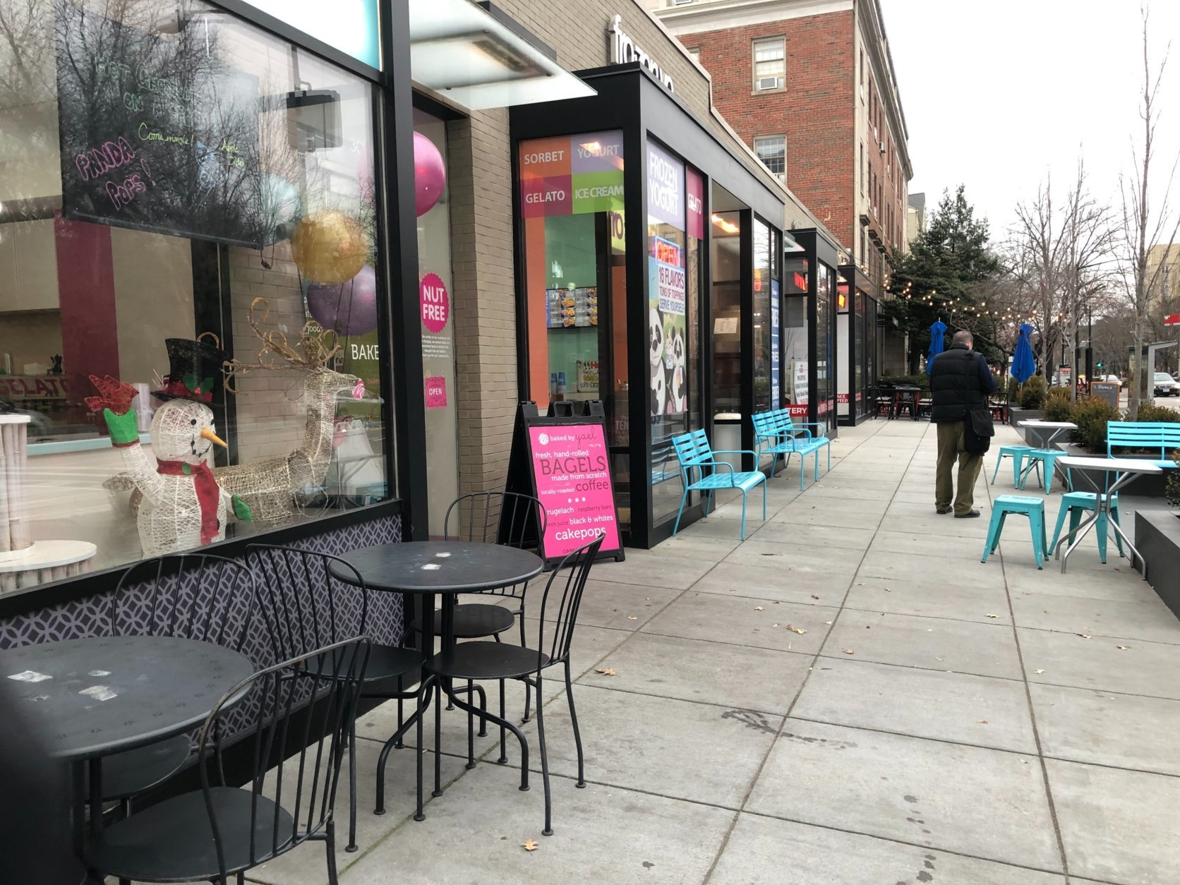 """We went from having thousands of people every day for Zoo Lights in December to having nobody in January,"" said Yael Krigman, of nearby shop Baked by Yael, while looking around at empty bistro tables. (WTOP/Kristi King)"