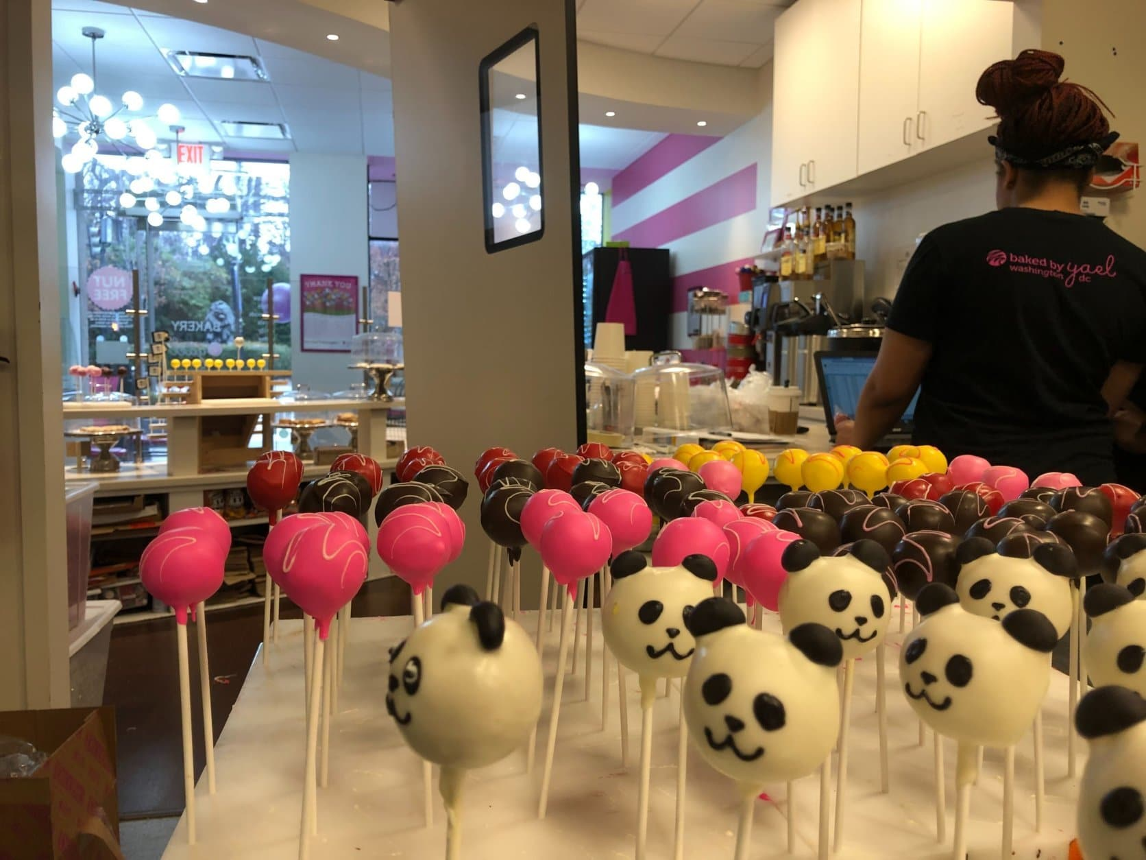 """""""If we lose all of our customers from the zoo, that's a problem,"""" said Krigman. Her bakery is among a strip of businesses on Connecticut Avenue directly across from the zoo in Northwest D.C. (WTOP/Kristi King)"""