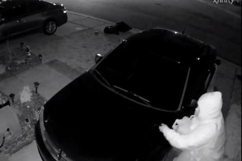 Video released of suspect in Anne Arundel Co. fire that damaged 2 cars, town house