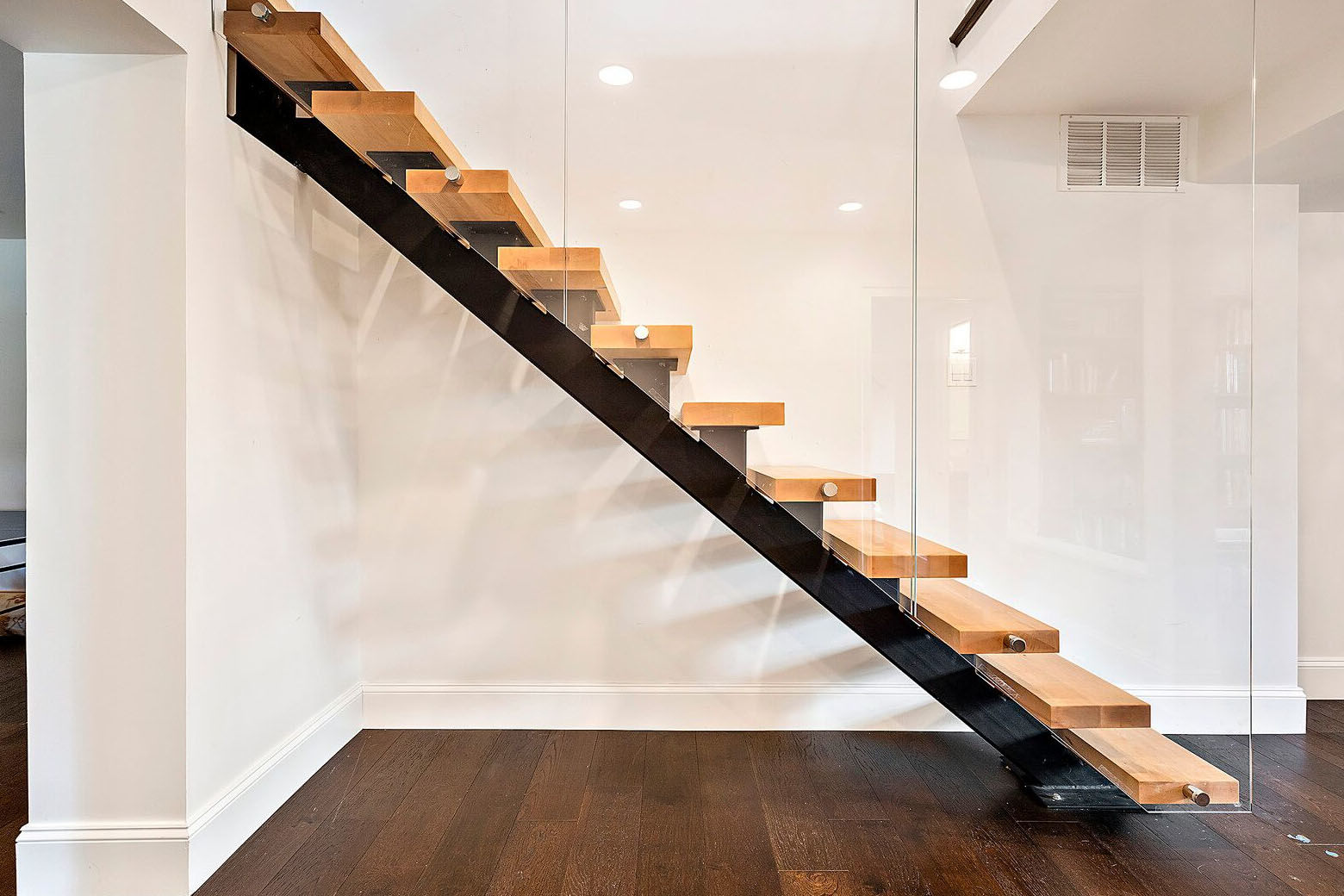 A floating staircase down the basement. (Courtesy Century 21 New Millennium/RealMarkets)