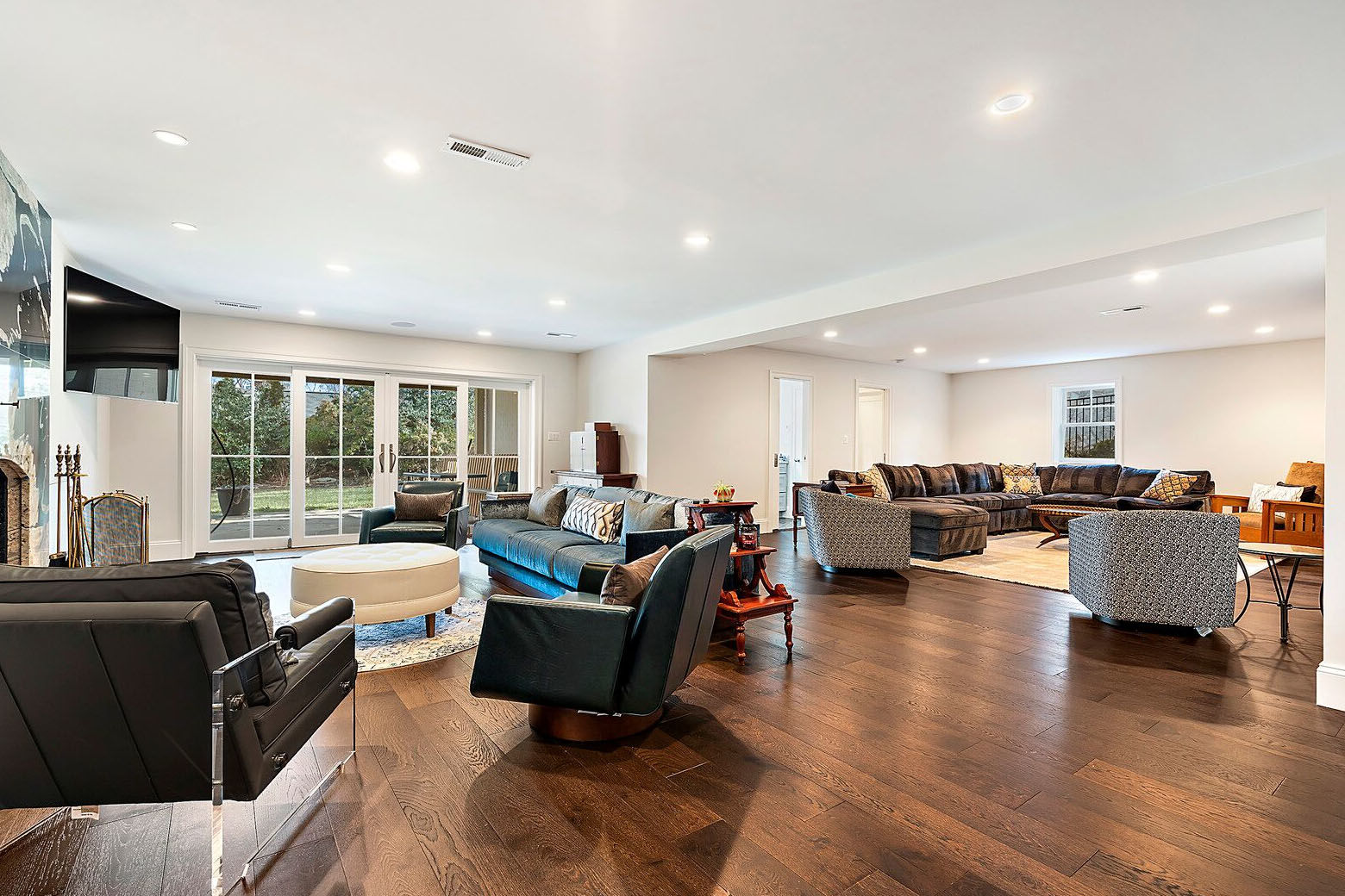 A family living space in the basement. (Courtesy Century 21 New Millennium/RealMarkets)