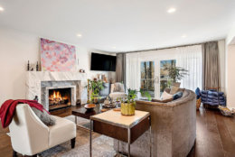The 5,512-square-foot house features walnut hardwood floors throughout the house. Other luxury features include a custom-designed gas fireplace with Carrera marble. (Courtesy Century 21 New Millennium/RealMarkets)