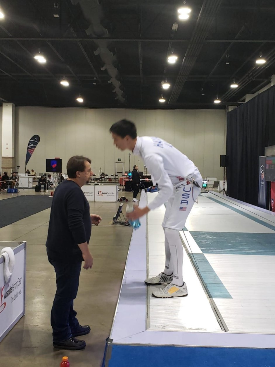 Justin Haddad in the finals match, getting advice from DCFC Head Coach Janusz Smolenski. (Courtesy D.C. Fencer's Club)