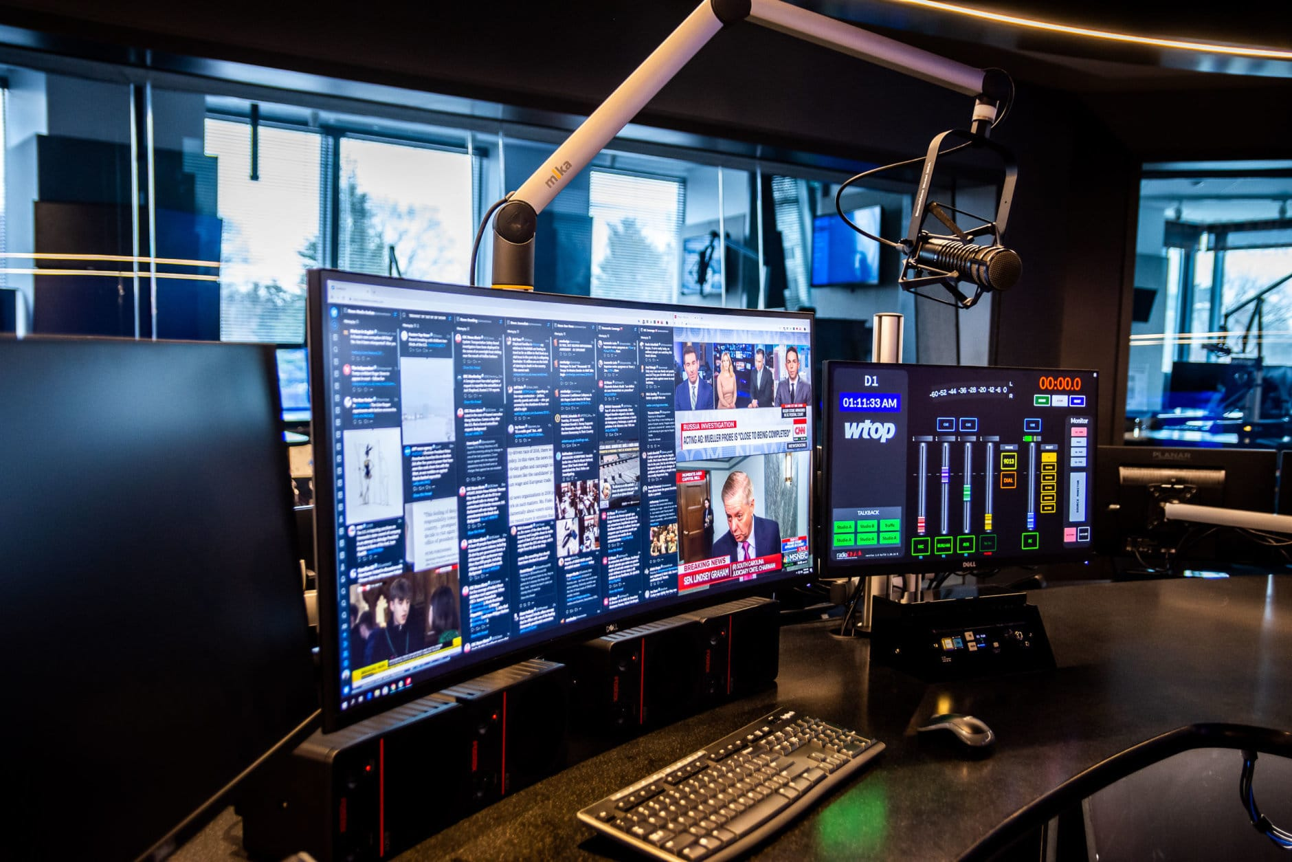 The Digital Editor is in charge of overseeing the minute-to-minute coverage of WTOP.com, deciding what stories go on the homepage, editing stories and coordinating with management, radio editors and reporters how stories will be presented online. Pictured is the new Digital Editor's desk, serving as the center of operations for WTOP's website, mobile apps and social media feeds. It comes equipped with a 34-inch curved ultrawide monitor — for a digital editor, there's no such thing as too much screen space. (WTOP/Alejandro Alvarez)