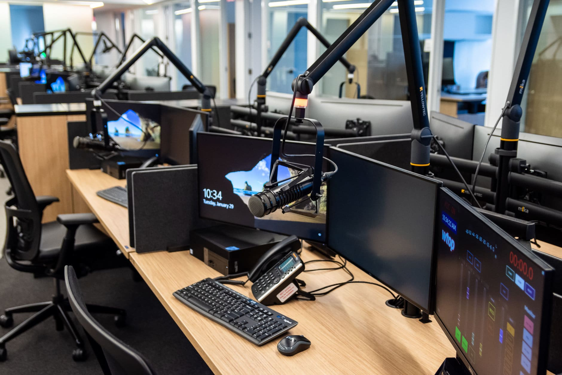 WTOP's new office space, shared with sister station Federal News Radio, is just under 31,000 square feet in an eight-story building just a short walk from the Friendship Heights Metro station in Maryland. The extra space allows for a whole array of new technology, including recording equipment at every station and larger screens for the digital team (pictured). Most work stations also have the ability to convert into standing desks with the push of a button. (WTOP/Alejandro Alvarez)