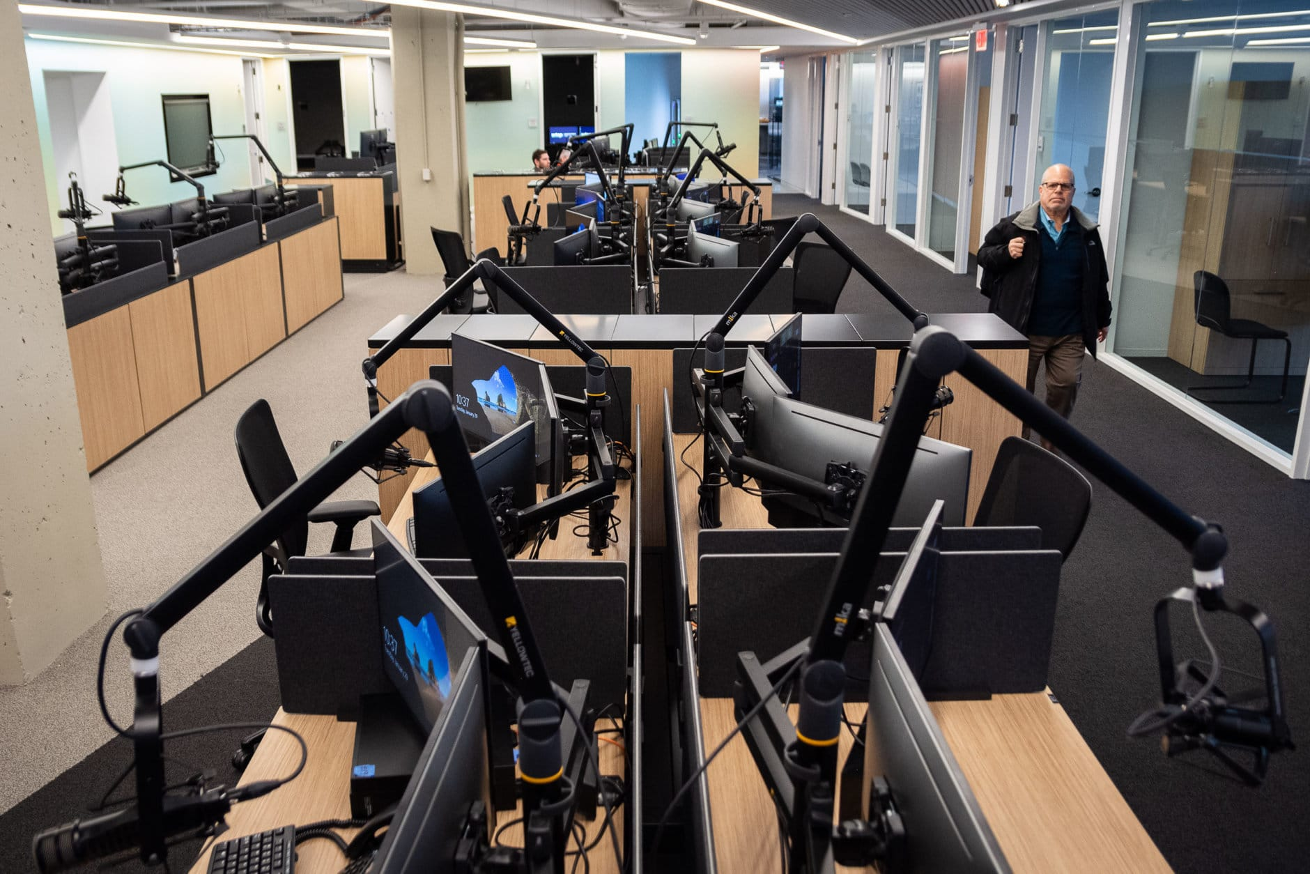 WTOP's new digital reporting and web development sections feature 24 work stations, all fitted with virtual mixers and microphones — a space age upgrade for the D.C. region's largest all-news format radio oulet. The new office space finally allows for all of WTOP's departments to coexist on the same floor, and is 8,000 square feet larger than the 30-year-old newsroom at Idaho Avenue.(WTOP/Alejandro Alvarez)