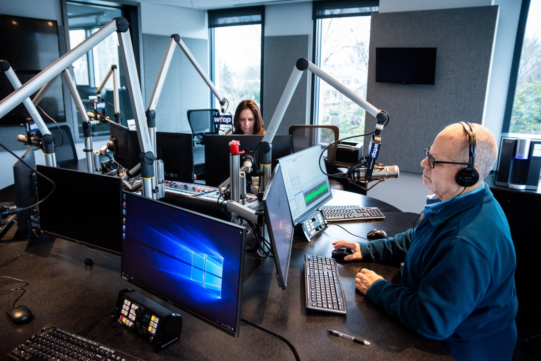 Bruce Alan and Joan Jones — the voices of WTOP during morning rush hour — conduct an off-air practice run from the new main studio on 5425 Wisconsin Avenue. While WTOP's broadcast format remains the same despite the move, the new studio debuts state-of-the-art software and equipment, assembled and tested over the course of months to ensure a seamless transition from the old building at midnight on Feb. 4. (WTOP/Alejandro Alvarez)
