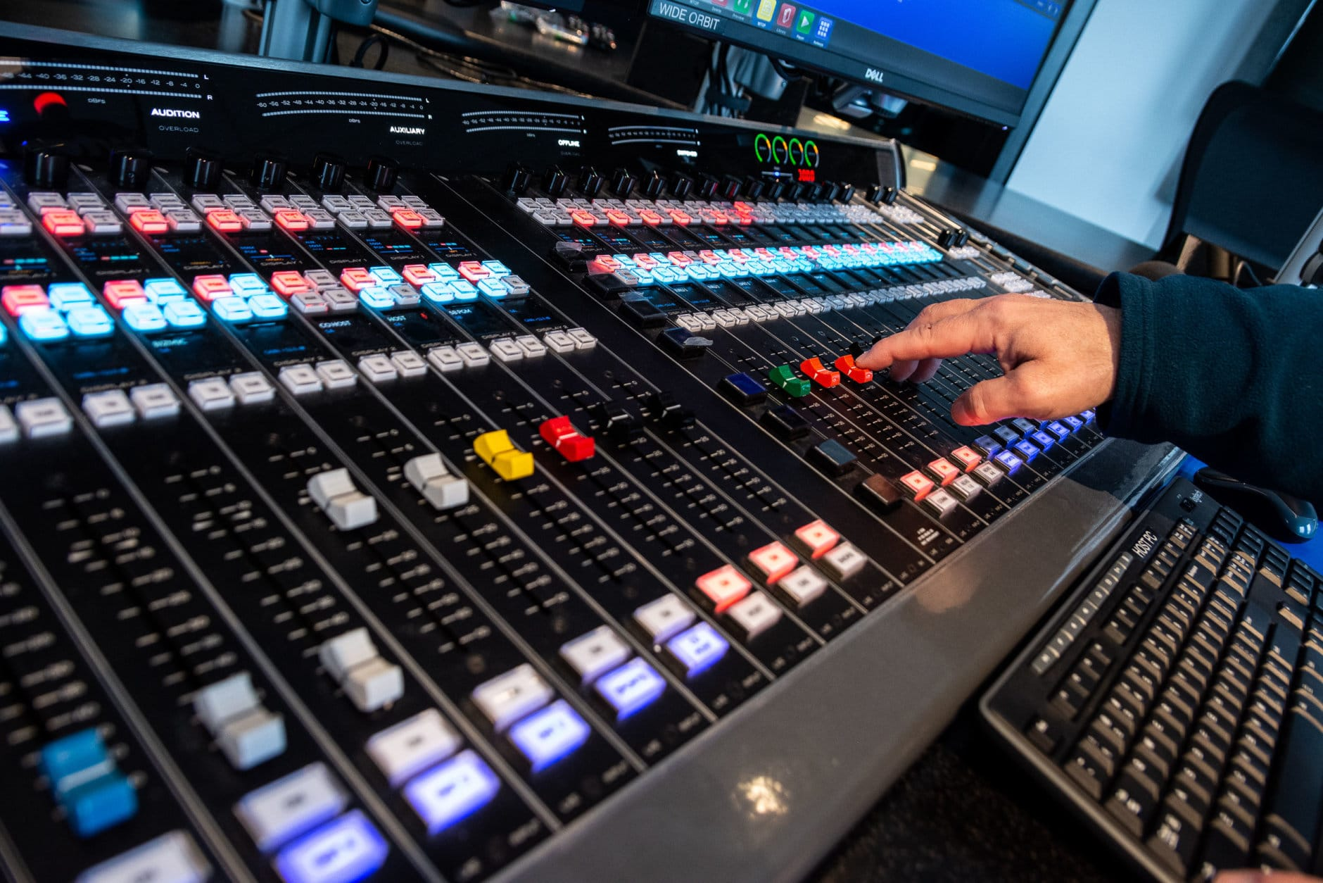 A close-up view of the main control board in WTOP's new Glass-Enclosed Nerve Center. With this audio mixer, an anchor can feed live audio from any of the 47 editing stations throughout the new office, or pre-recorded news reports from WTOP's affiliates. (WTOP/Alejandro Alvarez)