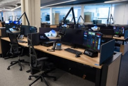 A typical reporter work station in WTOP's Wisconsin Avenue newsroom. Most stories from WTOP's radio reporters will be filed from stations like this one, featuring a virtual audio mixer, new system for phone interviews and the ability to go live on-air through the main control board located nearby in the new Glass-Enclosed Nerve Center. They can also convert into standing desks with the push of a button. (WTOP/Alejandro Alvarez)