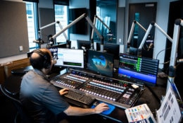 WTOP reporter Mike Murillo programs and calibrates audio sources feeding into the main studio's brand-new broadcast control board. From this station, an anchor can control WTOP's broadcast in real-time by changing volume levels, toggling dozens of audio feeds and playing pre-recorded ads or news reports. (WTOP/Alejandro Alvarez)
