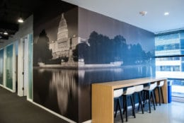 The Wisconsin Avenue building offers much more seating space for staff than the last, spread out over a larger area. This relatively secluded corner, with a mural of the Capitol and a bird's eye view of Western Avenue, is sure to become a certain reporter's favorite space for a breather.(WTOP/Alejandro Alvarez)
