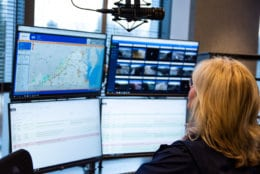 WTOP traffic reporter Mary de Pompa at her work station in the new Traffic Center. With more screens and updated technology, the Traffic Center will be able to monitor more camera and scanner feeds for a wider view of the situation on the roads. (WTOP/Alejandro Alvarez)