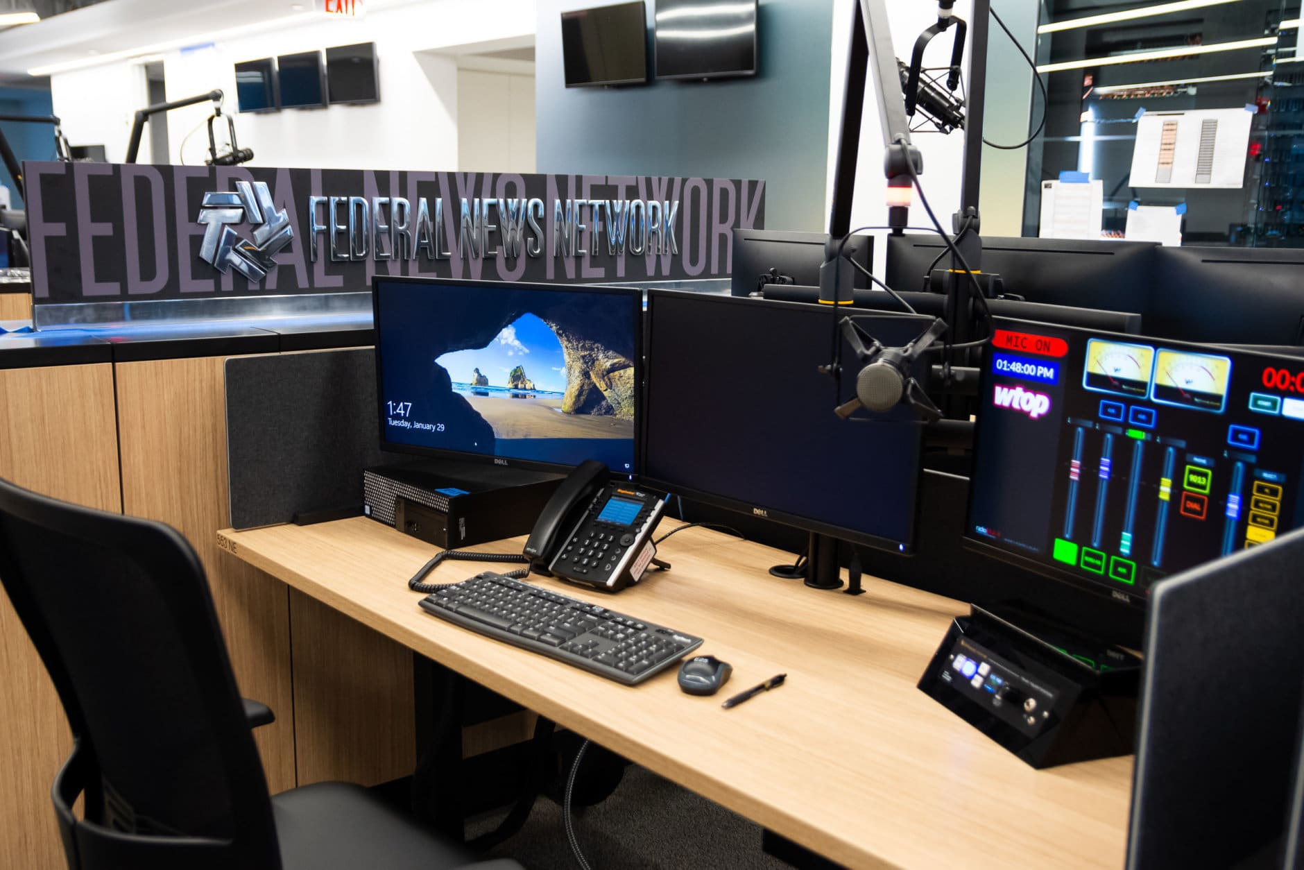 A typical work station at the recently rebranded Federal News Network, WTOP's sister station providing news for federal employees. Mere seconds from the WTOP side of the office, the new building will be the first time both WTOP and WFED have shared the same floor space. (WTOP/Alejandro Alvarez)