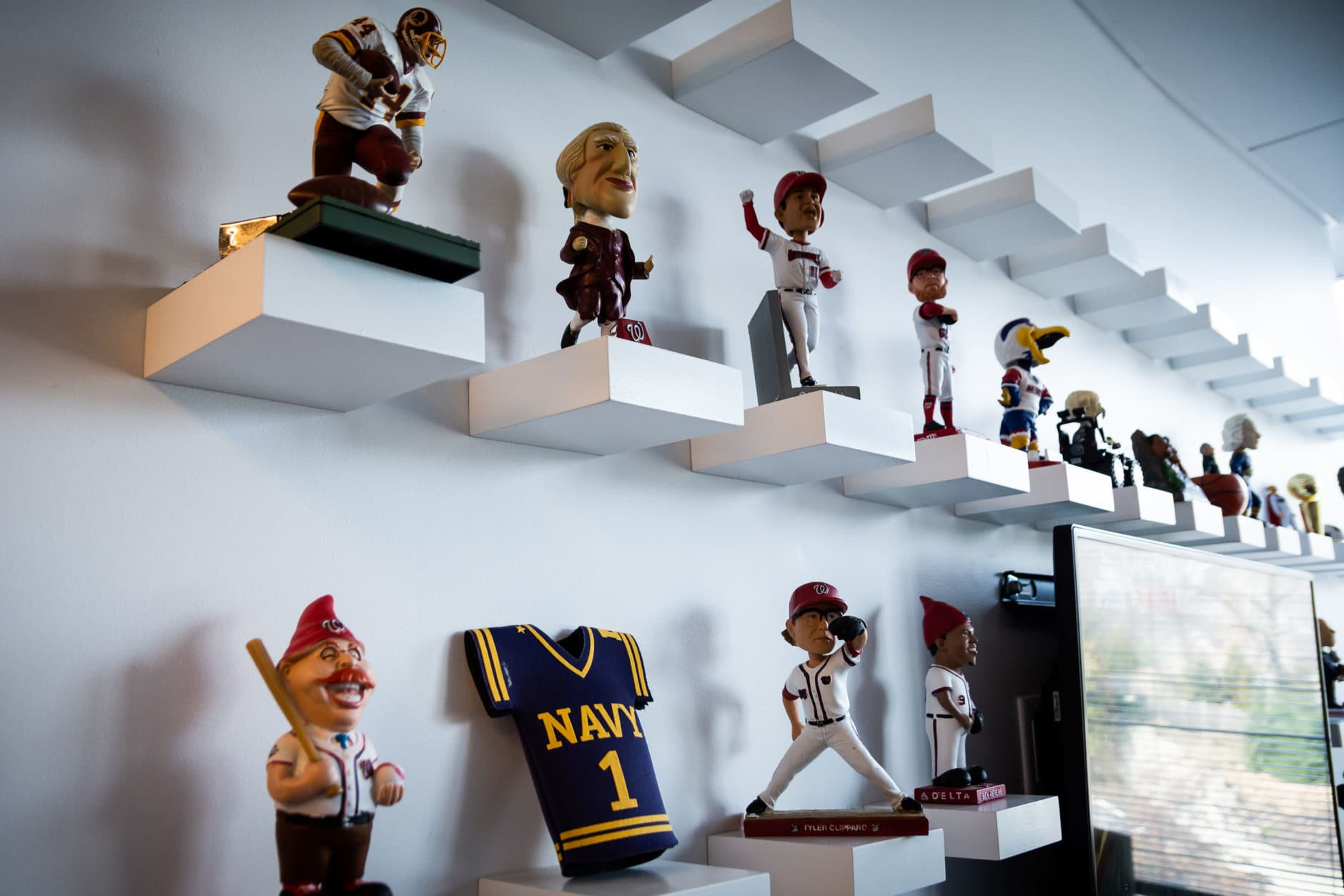 It's a work in progress, but the sports desk's bobblehead armada is slowly coming together. (WTOP/Alejandro Alvarez)