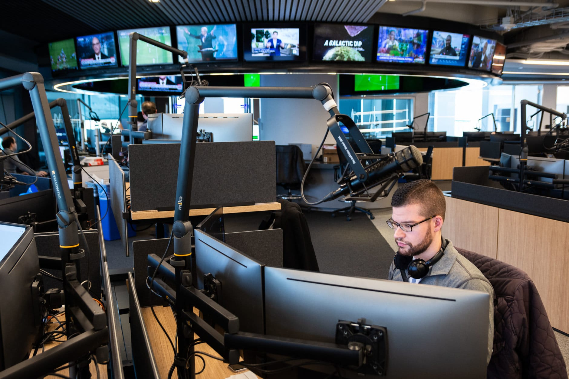 Sunday, Feb. 3 was the Wisconsin Avenue newsroom's first full day in action. After a smooth handoff from the Idaho Avenue office, WTOP's on-air and web teams were settling in to their new desks. Pictured: Digital writer Jack Moore, hard at work reporting on a controversy enveloping Virginia Gov. Ralph Northam. (WTOP/Alejandro Alvarez)