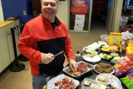 WTOP editor Mike Jakaitis slicing salami for the newsroom. (WTOP/Brandon Millman)