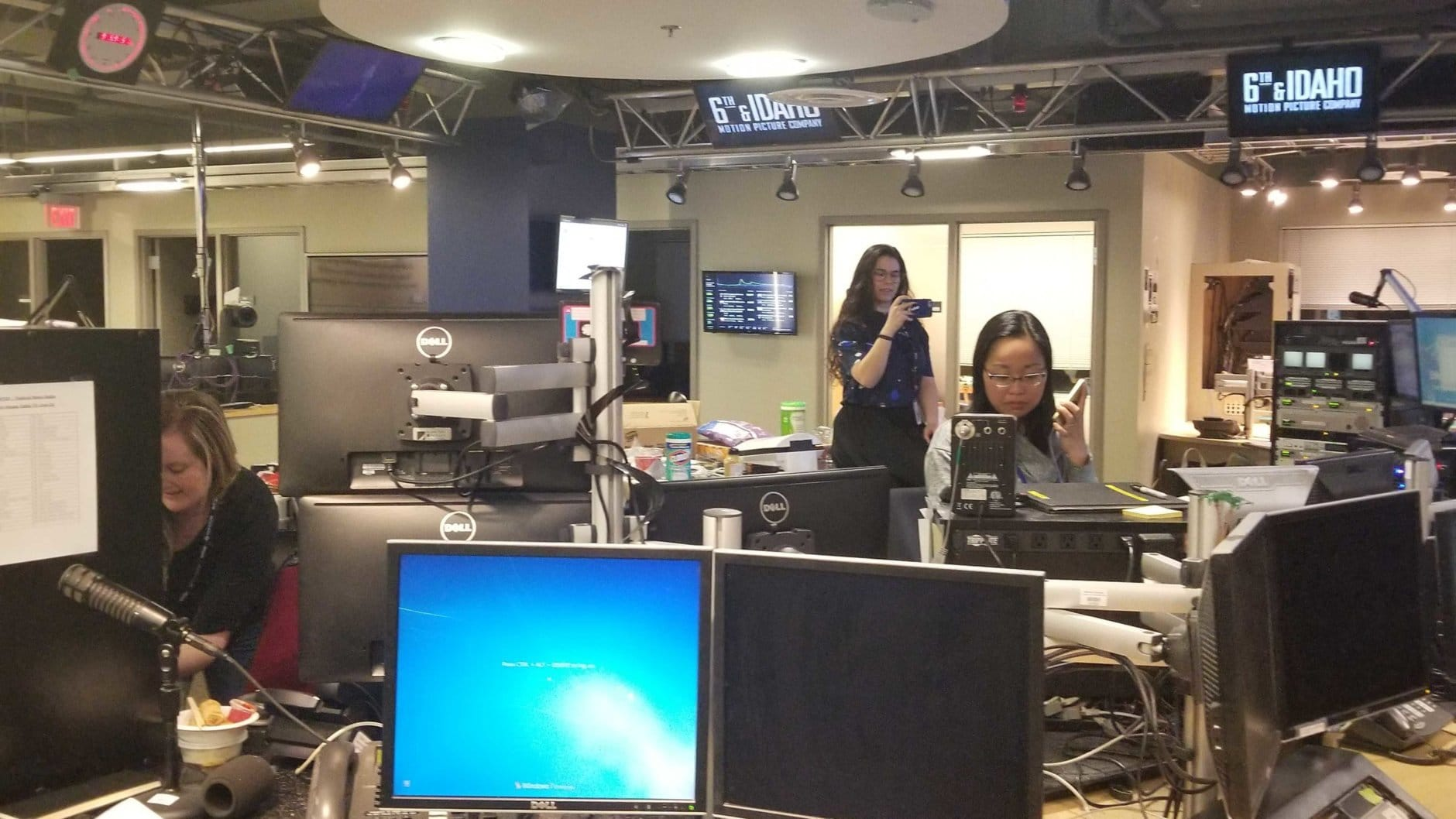 Editor Sae Robinson is on the phone with Editor Ana Srikanth who is in the new building. The transition is complete. (WTOP/Albert Shimabukuro)