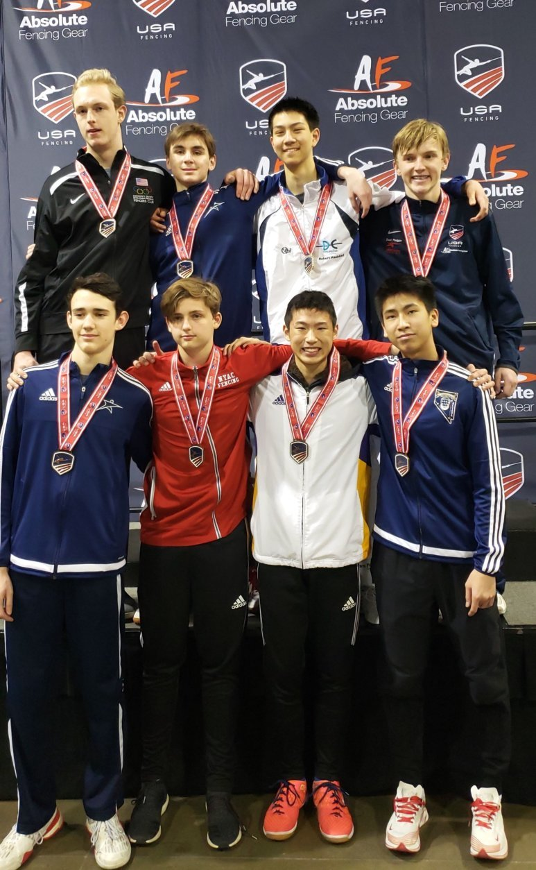 Justin Haddad on the podium with the top eight in Cadet Men's Epee.  Feb. 18, 2019 at the USA Fencing Junior Olympic Championships in Denver, Colorado. (Courtesy D.C. Fencer's Club)