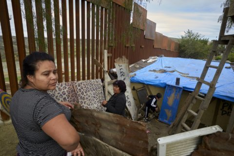 New US-Mexico border barrier charts tricky course near homes