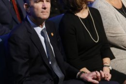 Virginia Gov. Ralph Northam, left, and his wife Pam, wait for the start of the funeral for fallen Virginia State Trooper Lucas B. Dowell at the Chilhowie Christian Church in Chilhowie, Va., Saturday, Feb. 9, 2019. Dowell was killed in the line of duty earlier in the week. (AP Photo/Steve Helber, Pool)