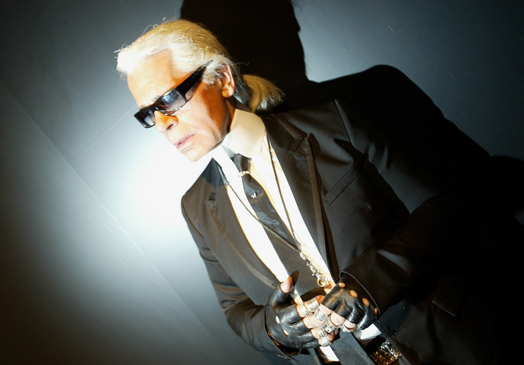 German Fashion designer Karl Lagerfeld is seen backstage during the presentation of Chanel's spring-summer 2005 haute couture fashion collection presented in Paris Tuesday Jan. 25, 2005.(AP Photo/Jerome Delay)