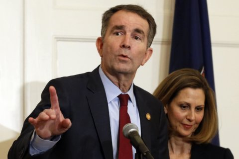 Northam says he is not person in racist yearbook photo, will not resign